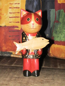 Wooden cat holding a fish.jpg