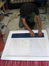 Solar panels - pressing a new row of cells.jpg
