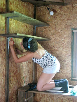 Beth making new kitchen shelves.jpg